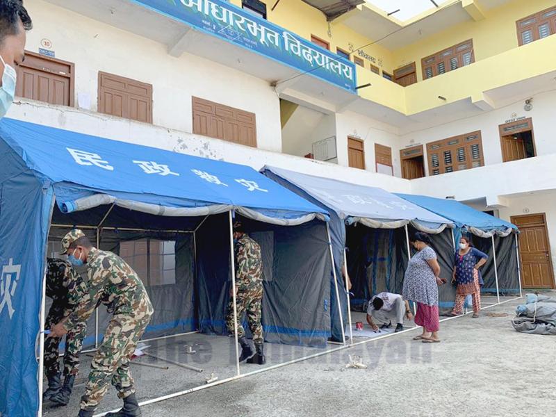 Kalibhanjyang Battalion of the Nepal Army preparing quarantine facility in Parashar Basic School, Byas Municipality-5, Tanahun, on Sunday, 29 March, 2020. Photo: Madan Wagle/THT