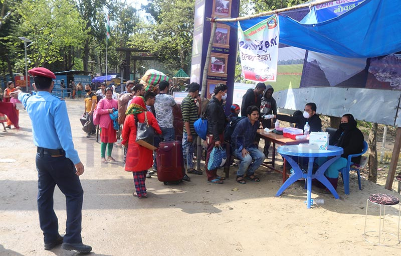 Health workers conducting check-up of people at the health desk established to prevent coronavirus spread at Mitranagar Customs point in Dhangadi, Kailali, on Monday. Photo: THT
