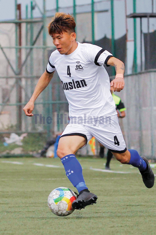 Dinesh Rai of SYC dribbles the ball during the Martyrs Memorial B Division League match against SKC in Lalitpur on Tuesday. Photo: THT