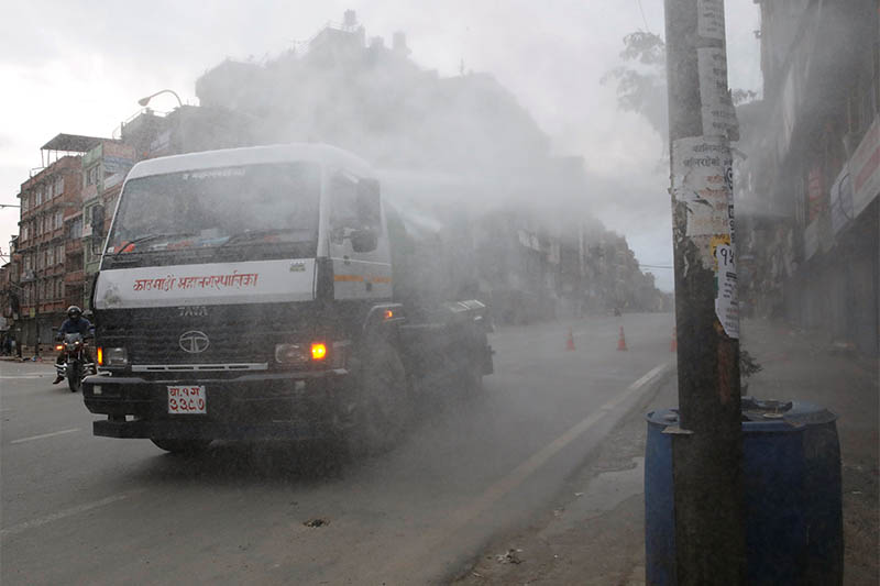 Disinfectant is sprayed from a vehicle during the lockdown imposed by the government amid concerns about the spread of coronavirus disease (COVID-19) outbreak, in Kathmandu, Nepal March 25, 2020. Photo: Reuters