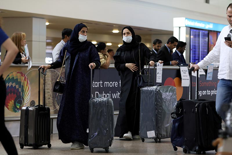 FILE -  Travellers wear masks as they arrive at Dubai International Airport, after the UAE's Ministry of Health and Community Prevention confirmed the country's first case of coronavirus, in Dubai, United Arab Emirates, on January 29, 2020. Photo: Reuters