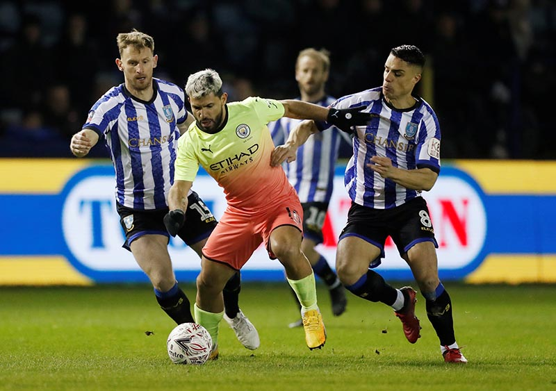 Manchester City's Sergio Aguero in action with Sheffield Wednesday's Tom Lees and Joey Pelupessy during the FA Cup Fifth Round match between Sheffield Wednesday and Manchester City, at Hillsborough, Sheffield, in Britain, on March 4, 2020. Photo: Action Images via Reuters