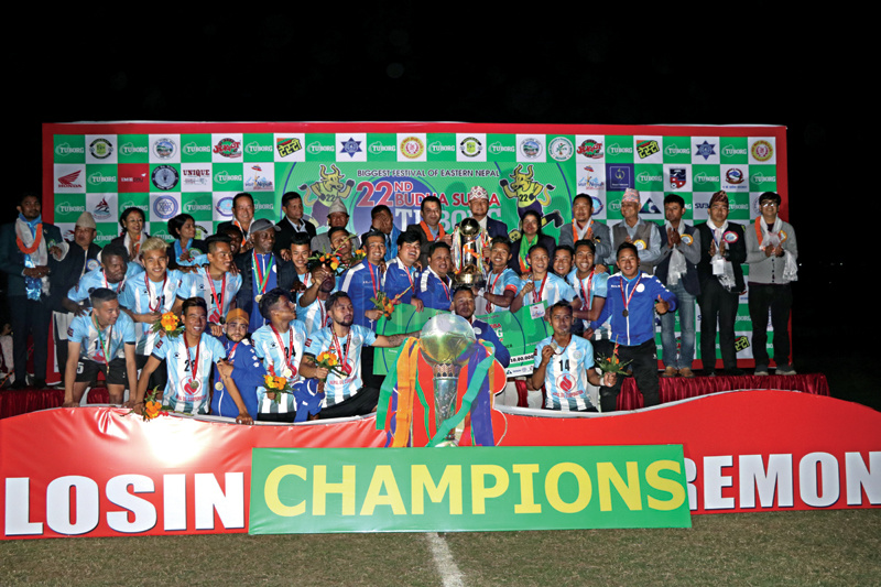 Players and officials of NOC Manang Marshyangdi Club celebrate with the trophy after winning the 22nd Budhasubba Tuborg Gold Cup in Dharan on Saturday. Photo: THT