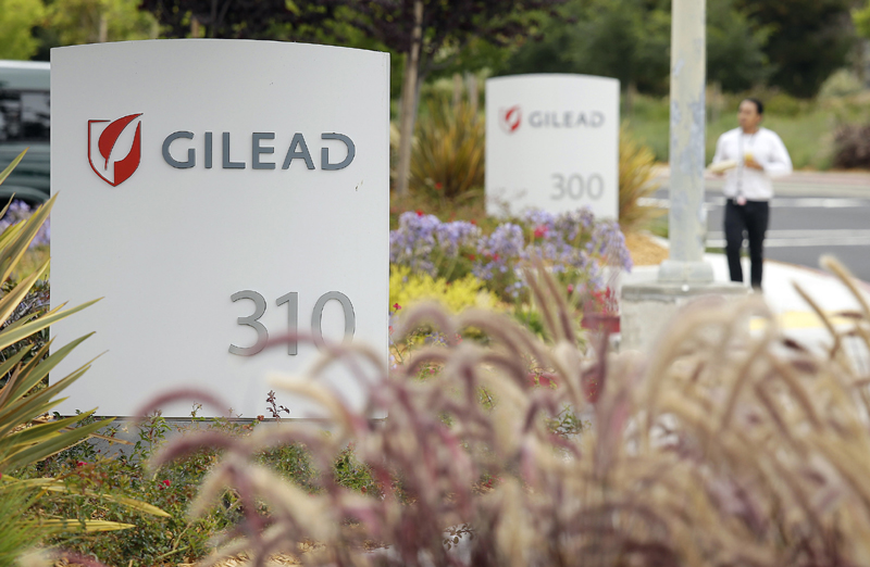 A man walks outside the headquarters of Gilead Sciences in Foster City, California July 9, 2015. Photo: AP/File