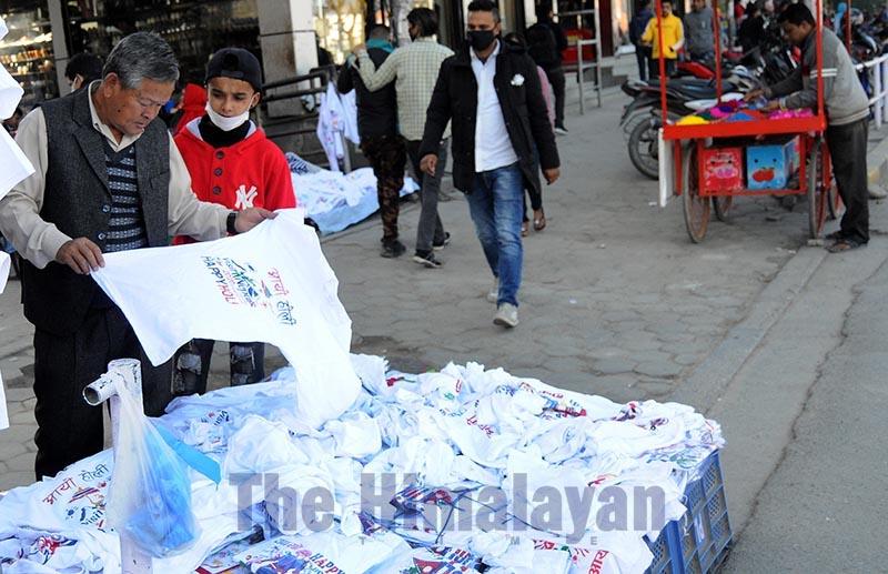 A man choosing a T-shirt to wear for Holi festivities at New Baneshwor, Kathmandu, on Sunday, March 8, 2020. Photo: Balkrishna Thapa Chhetri