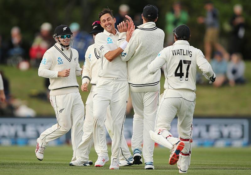 New Zealand's Trent Boult celebrates bowling India's Cheteshwar Pujara with teammates. Photo: Reuters