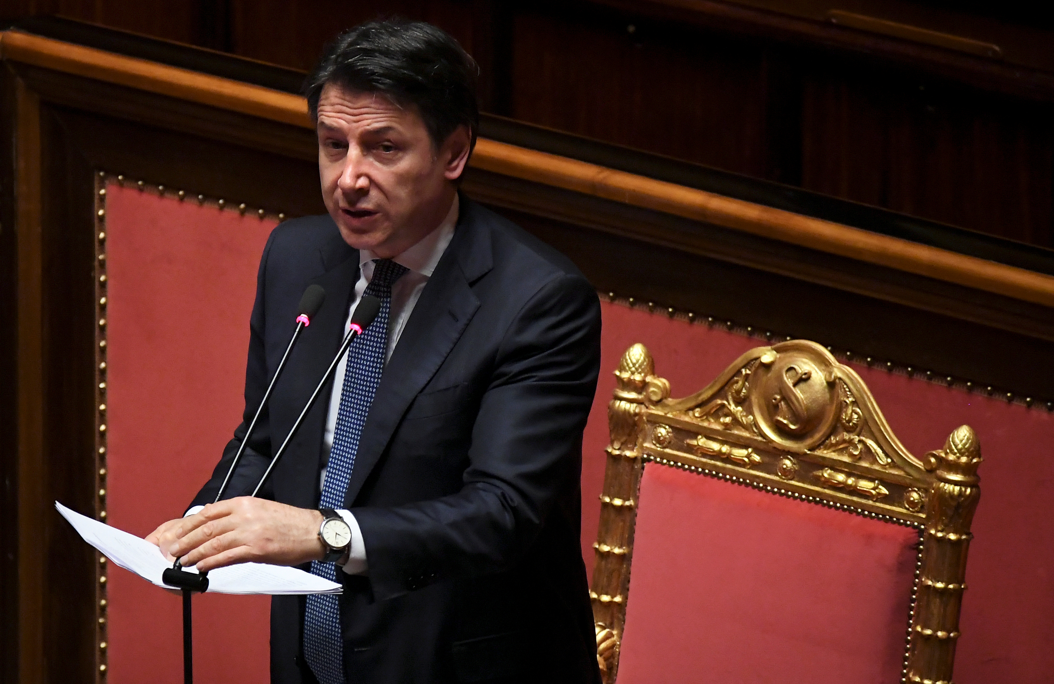 FILE PHOTO: Italian Prime Minister Giuseppe Conte addresses the Senate, the upper house of parliament, on the spread of coronavirus disease (COVID-19), in Rome, Italy, March 26, 2020 REUTERS/Alberto Lingria/File Photo