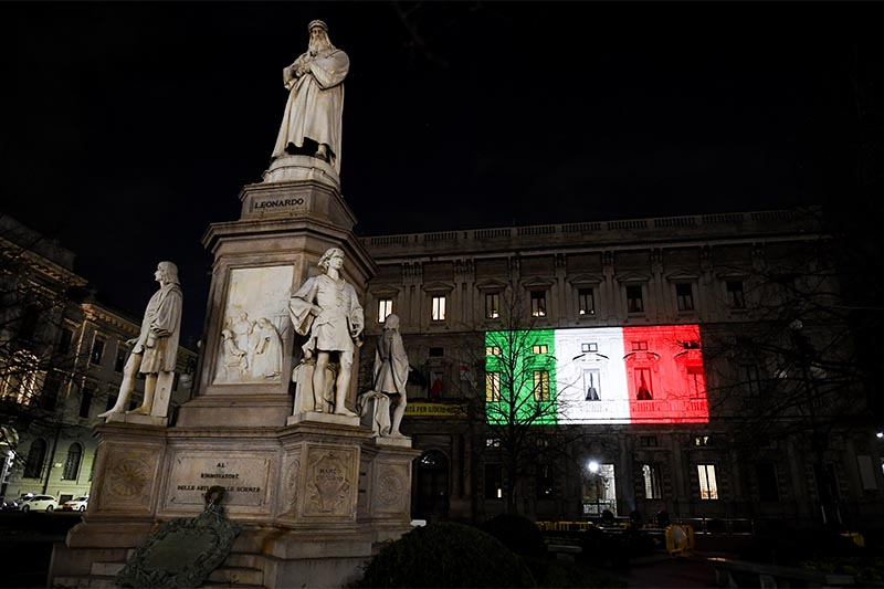 The Palazzo Marino building is seen iluminated with the colours of the Italian flag as the spread of coronavirus disease (COVID-19) continues, in Milan, Italy, on Friday, March 20, 2020. Photo: Reuters