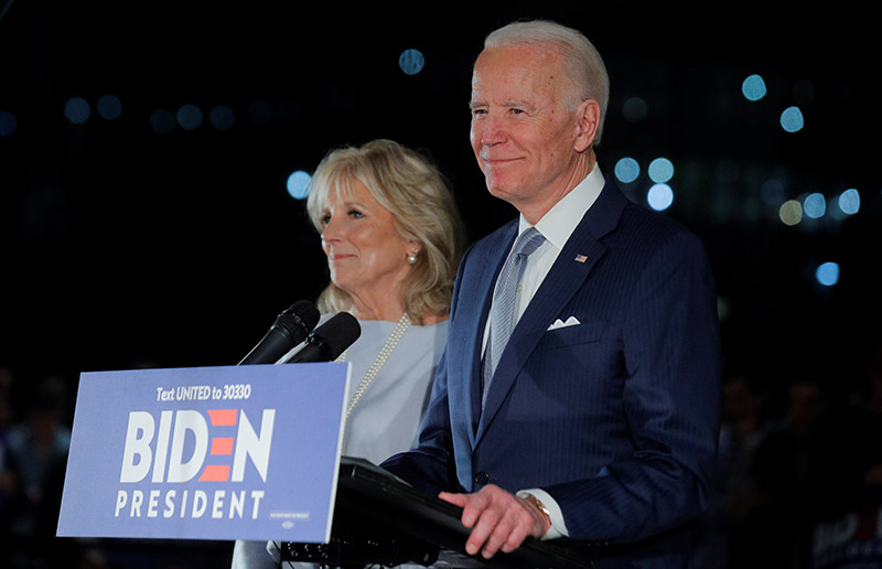 Democratic US presidential candidate and former Vice President Joe Biden speaks with his wife Jill at his side during a primary night speech at The National Constitution Center in Philadelphia, Pennsylvania, US, March 10, 2020. Photo: Reuters