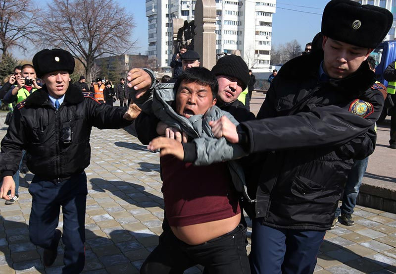 Kazakh law enforcement officers detain a protester during a rally held by opposition supporters, after anti-government activist has died of heart problems in a police detention center earlier this week, in Almaty, Kazakhstan March 1, 2020. Photo: Reuters
