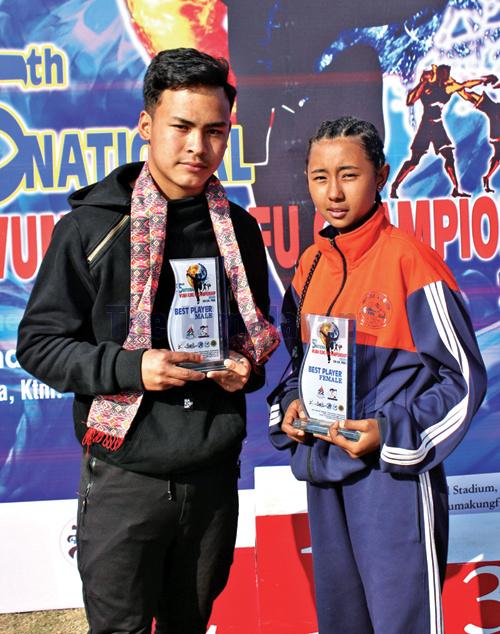 Surendra Thapa Magar and Salina Tamang hold their best player awards after the fifth National Wuma Kungfu Championship in Kathmandu on Saturday. Photo: THT