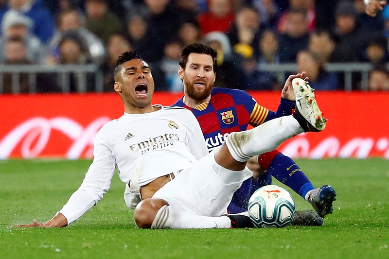 Real Madrid's Casemiro is fouled by Barcelona's Lionel Messi during their La Liga Santander match at Santiago Bernabeu, in Madrid, Spain, at March 1, 2020. Photo: Rueters