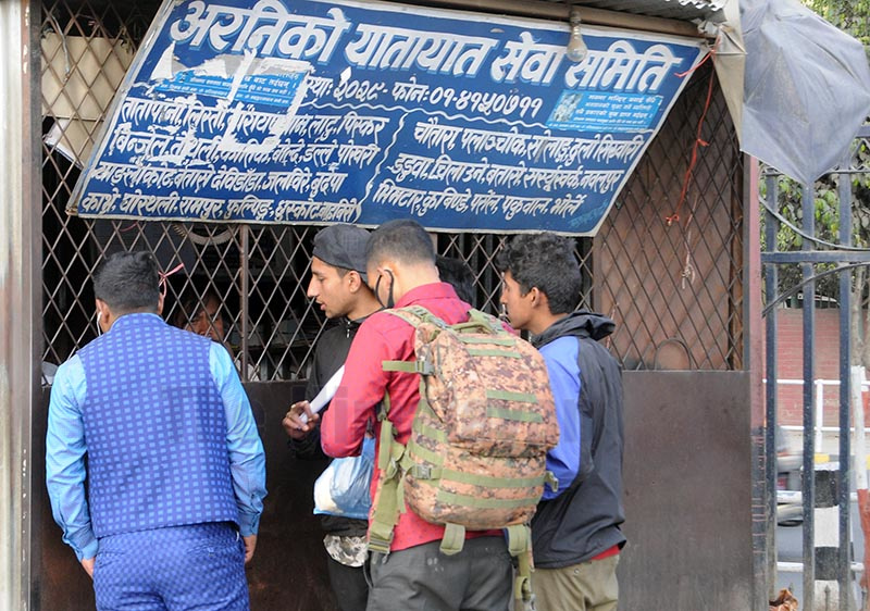 People gathering in front of a bus ticket counter in Kathmandu, on Thursday. People have started leaving after the government announced steps to counter COVID-19. Photo: Bal Krishna Thapa / THT