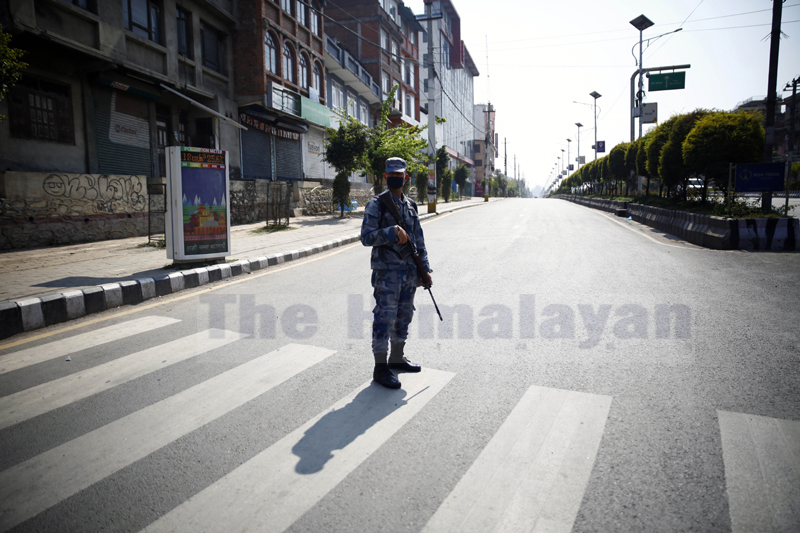 A policeman patrols the street on the second day of the week-long nationwide lockdown, in an effort to control the spread of COVID-19, in Kathmandu, on Wednesday, March 25, 2020. Photo: Skanda Gautam/THT