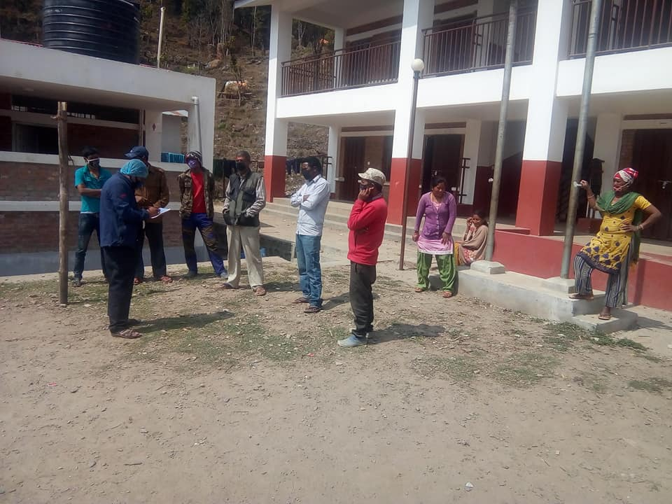 Health workers inquiring the visitors at a Narayandevi Basic School COVID-19 quarantine site in Netrajyoti Dabjong Rural Municipality of Dhading district. Photo: Keshav Adhikari/ THT