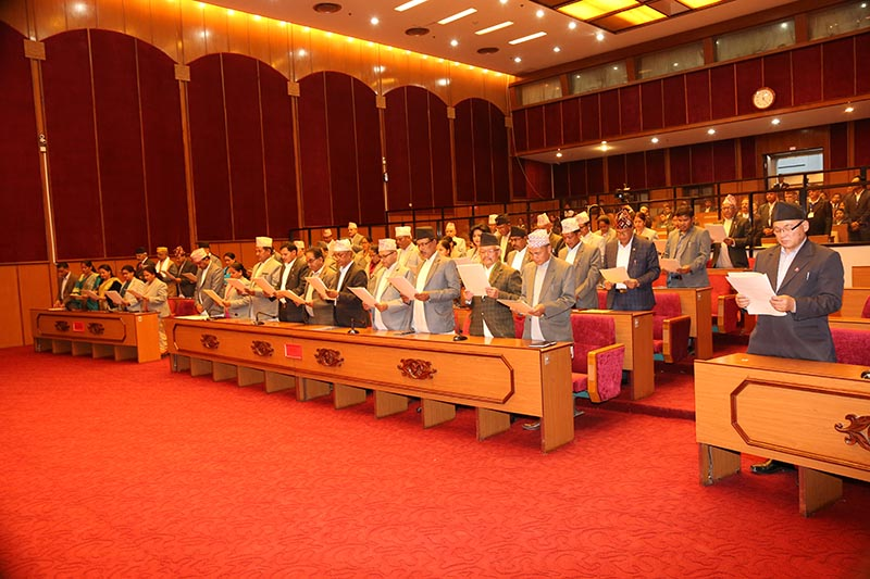 Newly elected members of the National Assembly, the Upper House in the Federal Parliament, taking oath of office and secrecy, at Parliament building in New Baneshwor, Kathmandu, on Wednesday, March 4, 2020. Photo courtesy: Nepal Parliament