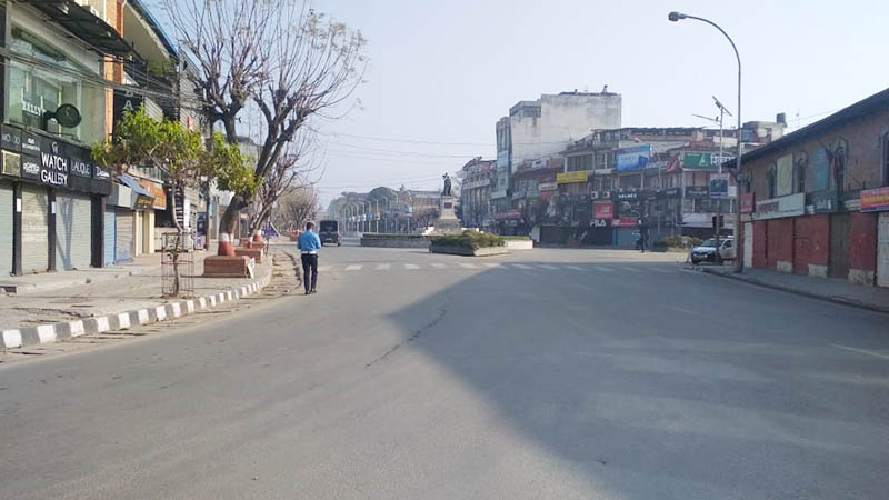 A traffic policeman walks in a road on the deserted Durbar Marga in Kathmandu as a lockdown is imposed to contain the coronavirus disease (COVID-19) in Nepal, on Tuesday, March 24, 2020. Photo: Suresh Chaudhary/THT