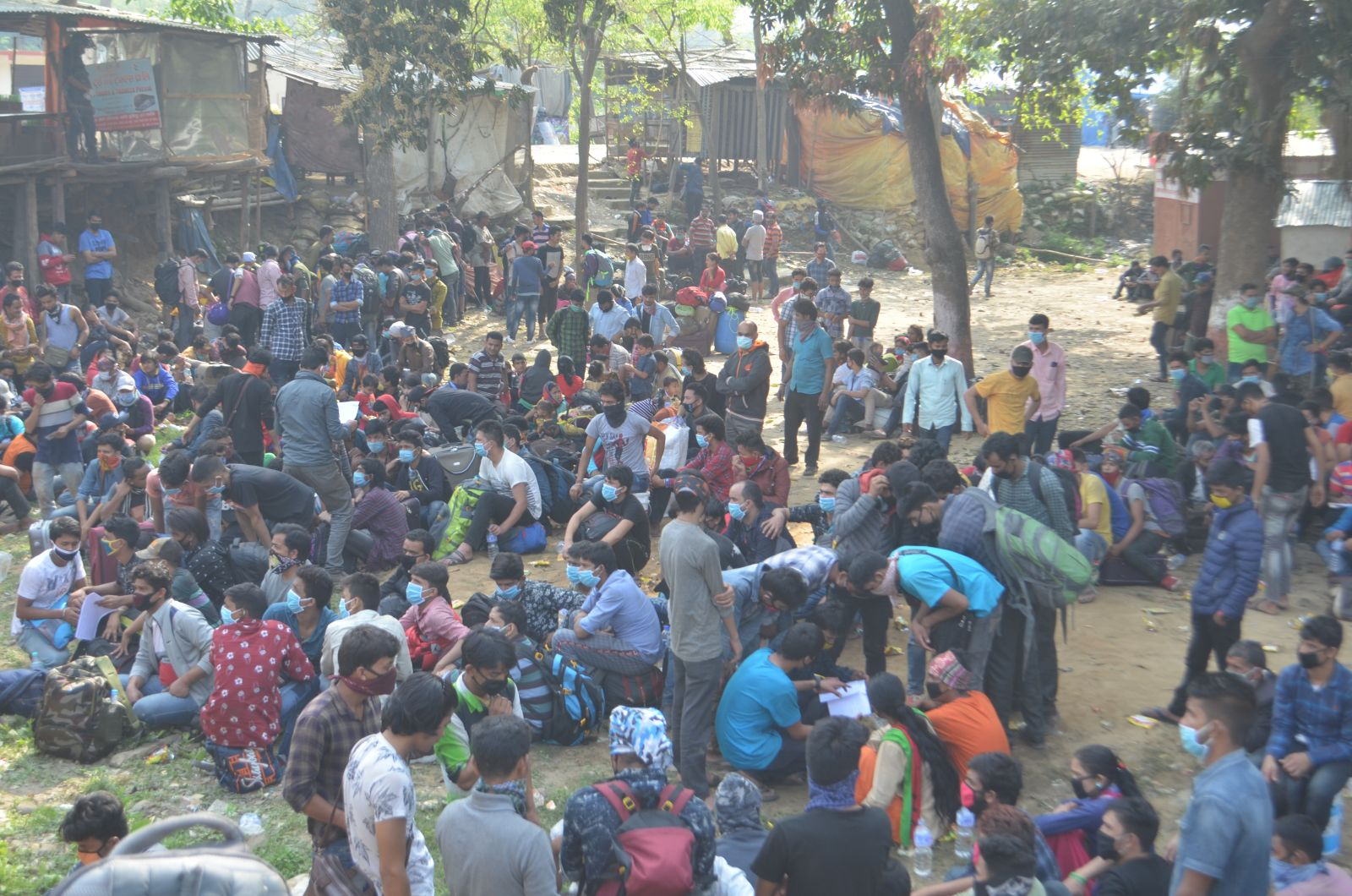 Nepali citizens stranded at the far-western border points after the government declared a lockdown to contain the possible spread of COVID-19. Photo: Tekendra Deuba/THT
