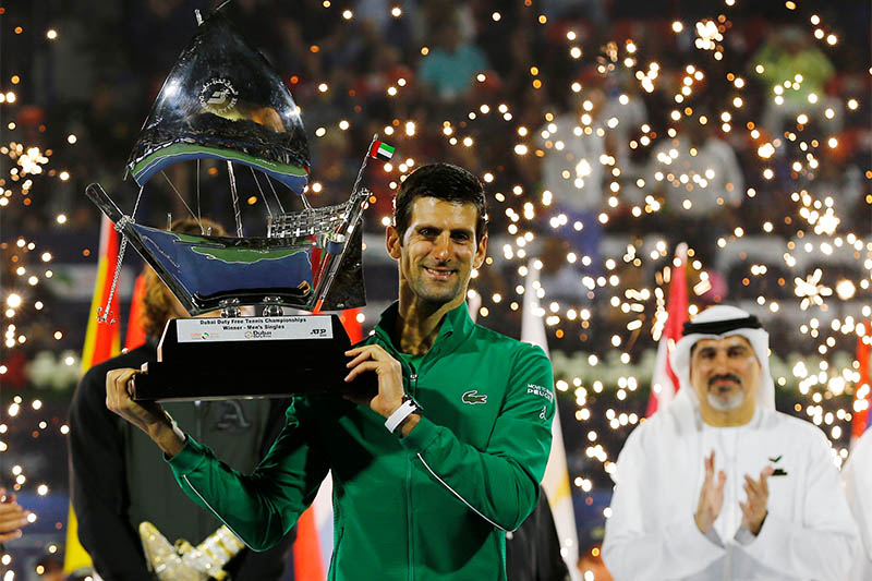 Serbia's Novak Djokovic poses with the trophy after winning the Final against Greece's Stefanos Tsitsipas. Photo: Reuters