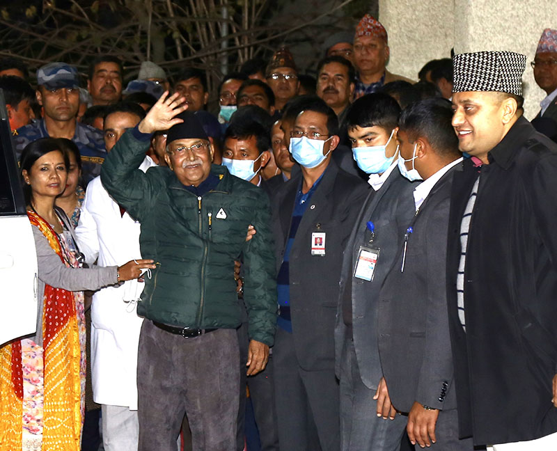 Prime Minister KP Sharma Oli waves his hands as he is discharged from TUTH as seen on Friday, March 13, 2020. Photo: RSS