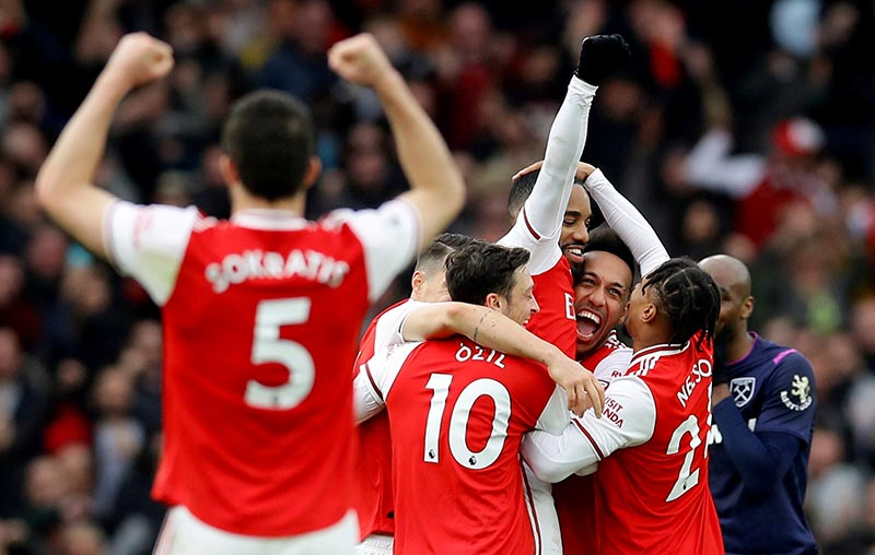 Arsenal's Alexandre Lacazette celebrates scoring their first goal with teammates during the Premier League match between Arsenal and West Ham United, at Emirates Stadium, in London, Britain, on March 7, 2020. Photo: Reuters