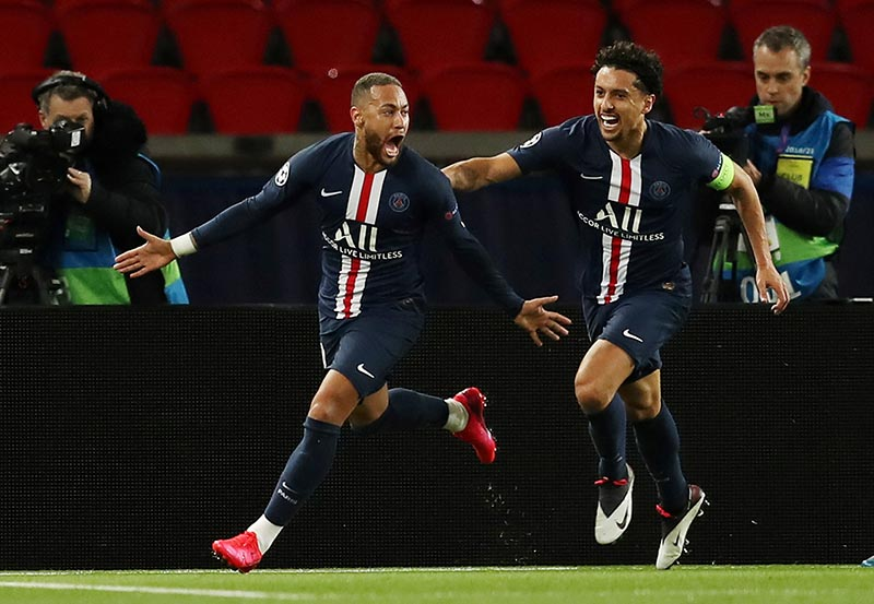 Paris St Germain's Neymar celebrates scoring their first goal with Marquinhos during the Champions League Round of 16 Second Leg match between Paris St Germain and Borussia Dortmund, at Parc des Princes, in Paris, France, on  March 11, 2020. Photo: UEFA Pool/Handout via Reuters