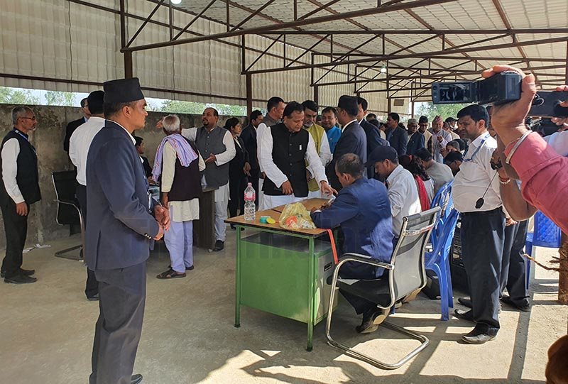 Province 2 Chief Minister Lal Babu Raut verifying his name at an election organised to fix the name and capital of the province, in Janakpur, on Tuesday. Photo: THT