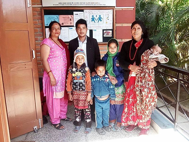 Helpless children posing for a photograph with representatives of SOS Balgram, Lumbini, in Jagannath Rural Municipality, Bajura, on Saturday. Photo: THT