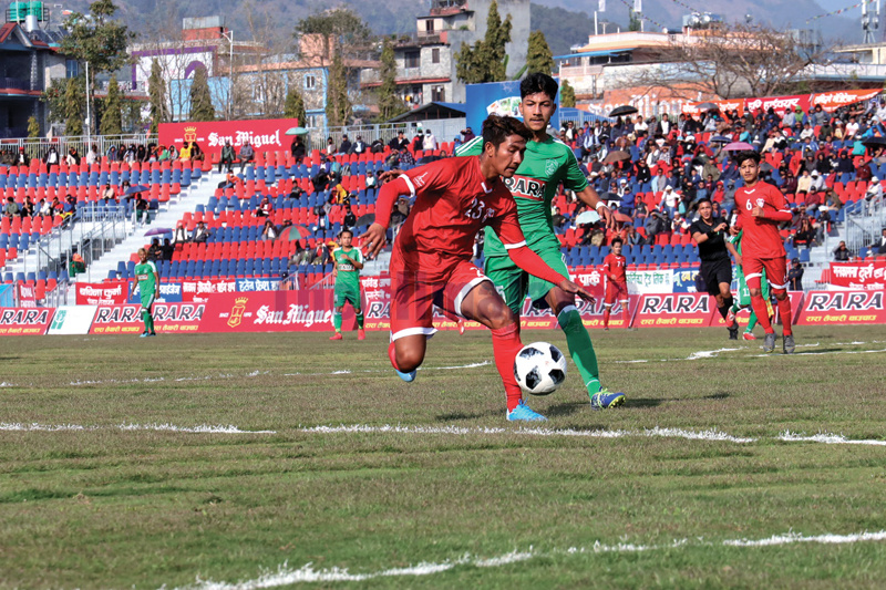 BBC's Rajesh Pariyar (left) tries to beat past his opponent from Sahara Club during the 18th Aaha-Rara Gold Cup at the Pokhara Stadium. Photo Courtesy: Sudarshan Ranjit