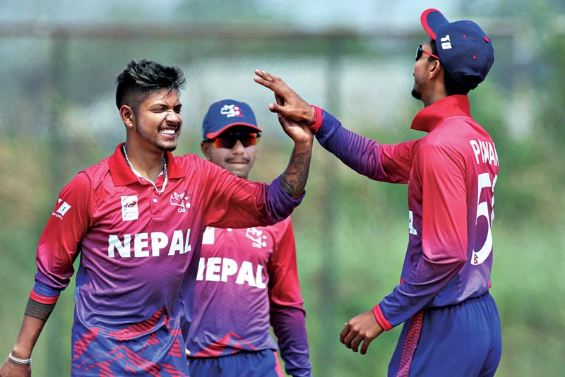 Sandeep Lamichhane (left) celebrating with teammate PawanSarraf after taking a wicket against Malaysia during their ACCEastern Region T20 match at Terdthai Cricket Ground in Bangkok, on Saturday Photo Courtesy: ACC