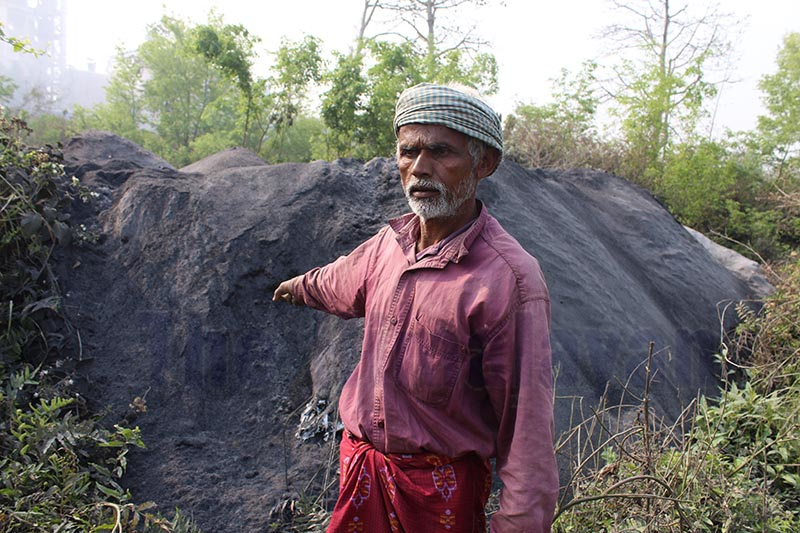 A local pointing at a pile of waste discharged by a distillery in Golbazaar Municipality, Siraha, on Saturday. Photo: THT