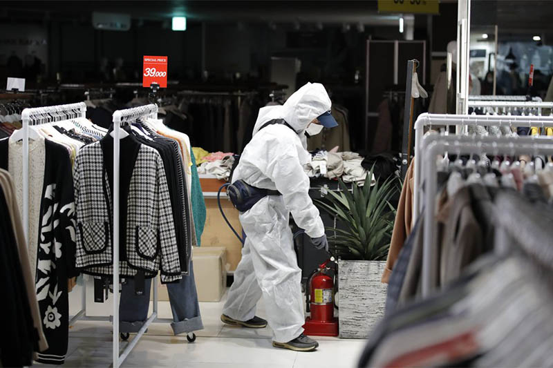A worker wearing protective gear sprays disinfectant as a precaution against the new coronavirus at a department store in Seoul, South Korea, Monday, March 2, 2020. South Korea has the world's second-highest cases. Photo: AP