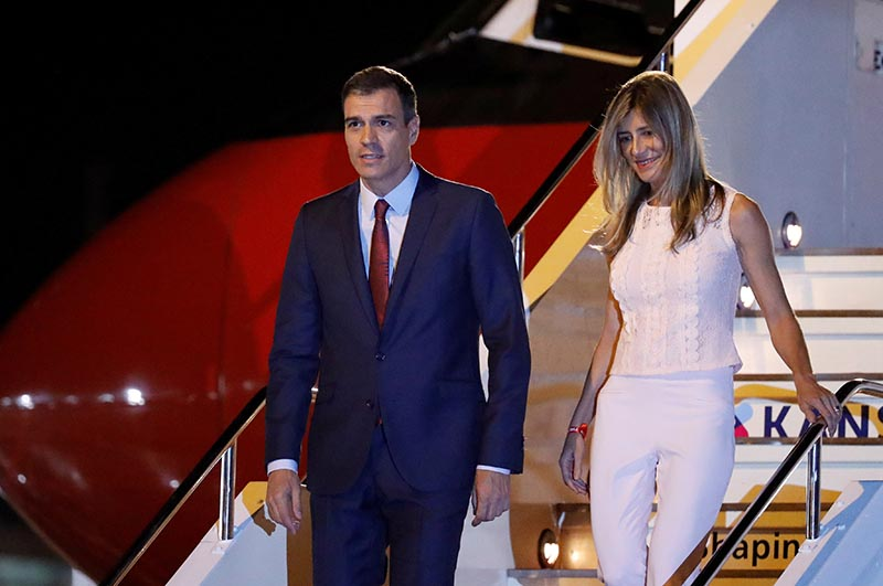 FILE - Spain's Prime Minister Pedro Sanchez and his wife Maria Begona Gomez Fernandez arrive ahead of the G20 leaders summit in Osaka, Japan June 27, 2019. Photo: Reuters