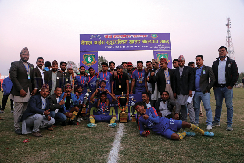 Sudurpashchim-XI Sports Club team members celebrate with officials after winning the Nepal Ice Sudurpashchim Khaptad Gold Cup at the Dhangadhi Stadium on Tuesday. Sudurpashchim defeated Ruslan Three Star Club 1-0 in the final match. Photo: THT