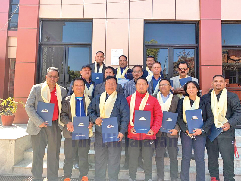 Officials pose for a group photo after receiving certificate of nomination in various sub-committees of the World Taekwondo Asia Standing Committee in Lalitpur on Thursday. Photo: THT