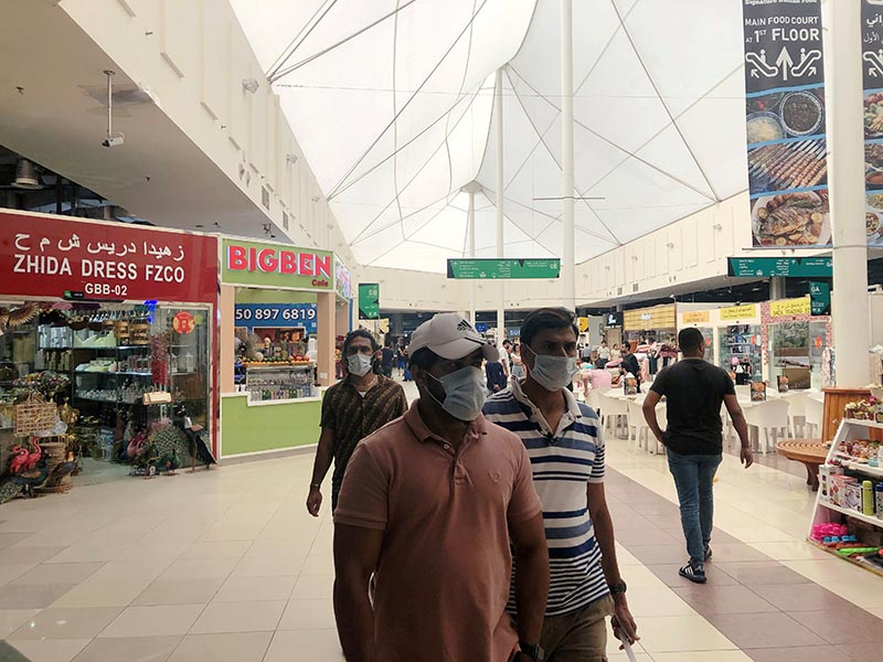 People wear protective face masks, following the outbreak of the new coronavirus, as they walk at Dragon Mart, a Chinese themed discount shopping centre, in Dubai, United Arab Emirates March 2, 2020. Photo: Reuters
