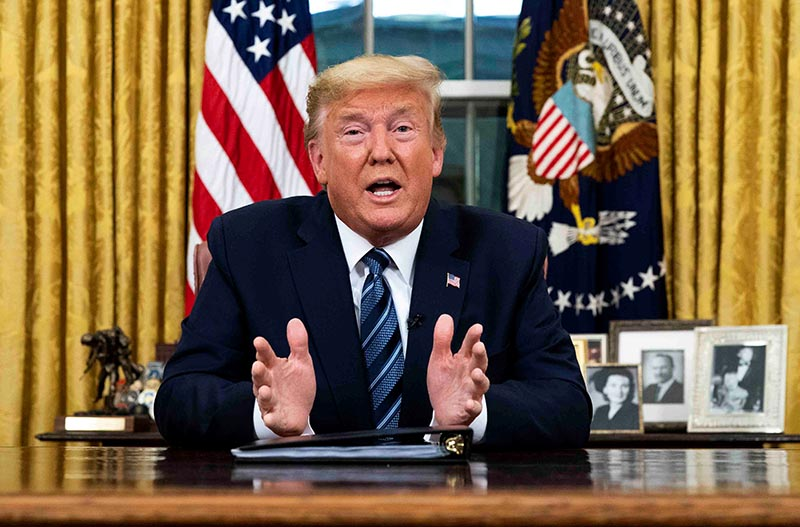 US President Donald Trump speaks about the US response to the COVID-19 coronavirus pandemic during an address to the nation from the Oval Office of the White House in Washington, US, March 11, 2020. Photo: Doug Mills/Pool via Reuters