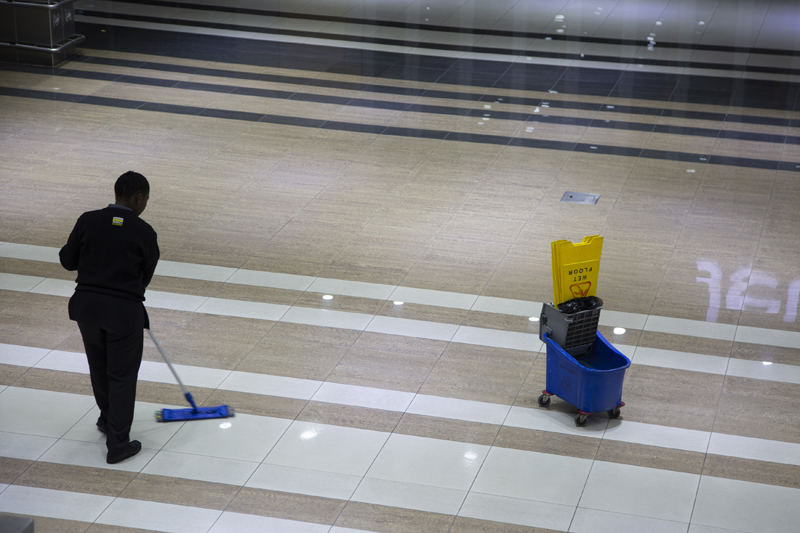 A cleaner mops a floor in a Johannesburg supermarket Wednesday, March 18, 2020 as a measure against the new coronavirus. Photo: AP