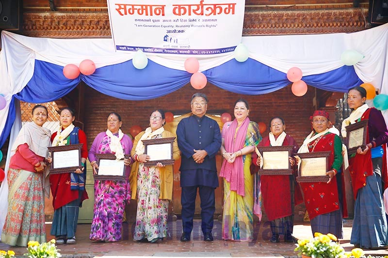 Women, who run homestays in different districts across the country, posing for photographs after being felicitated on the occasion of Women's Day at Maiti Nepal Office in Kathmandu, on Sunday, March 8, 2020. Photo: Sjanda Gautam/THT