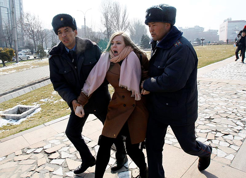 Kyrgyz law enforcement officers detain a women's rights activist during a rally on International Women's Day in Bishkek, Kyrgyzstan March 8, 2020. Photo: Reuters