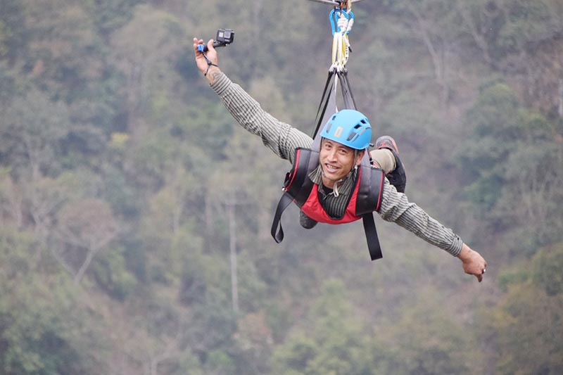 A woman enjoying zip lining in Bhedetar of Sangurigadi Rural Municipality, Dhankuta, on Sunday, March 8, 2020. Photo: RSS