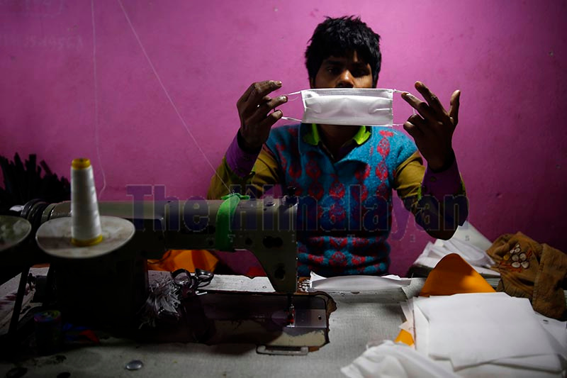 A worker preparing face masks in the wake of shortage of masks due to coronavirus scare in Kathmandu, on Saturday. Photo: Skanda Gautam/ THT