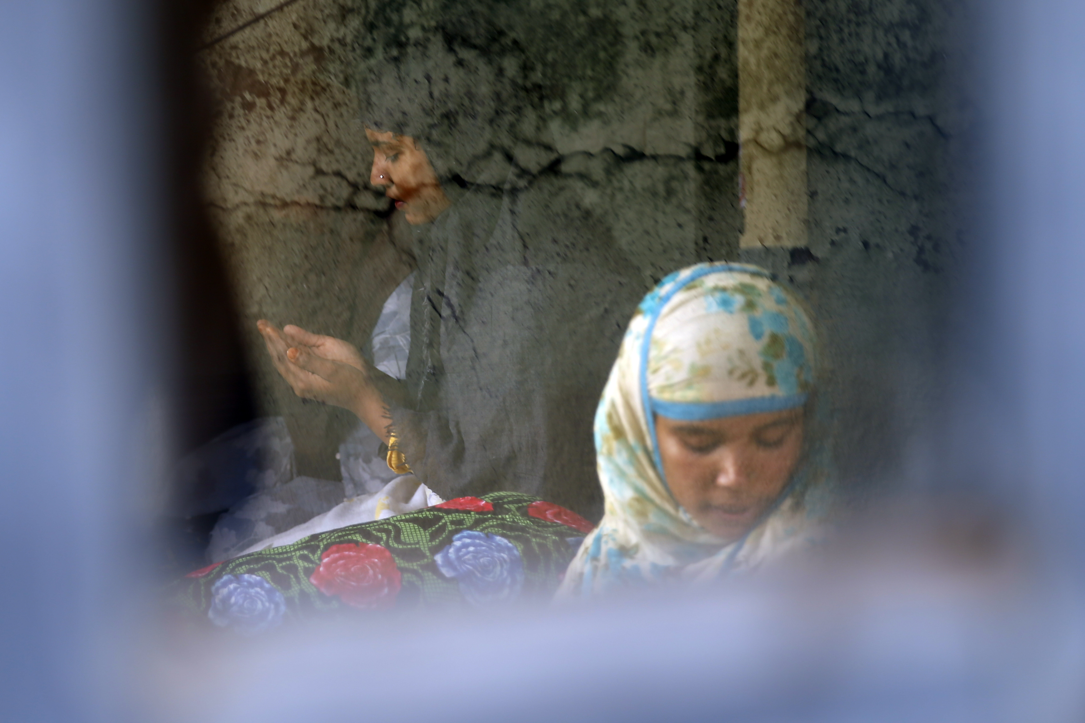 People from the Muslim community pray during the holy month of Ramadan at their home, on the 33rd day of government-imposed lockdown, amid concerns over the spread of COVID-19, in Kathmandu, on Saturday, April 25, 2020. Photo: Skanda Gautam/THT