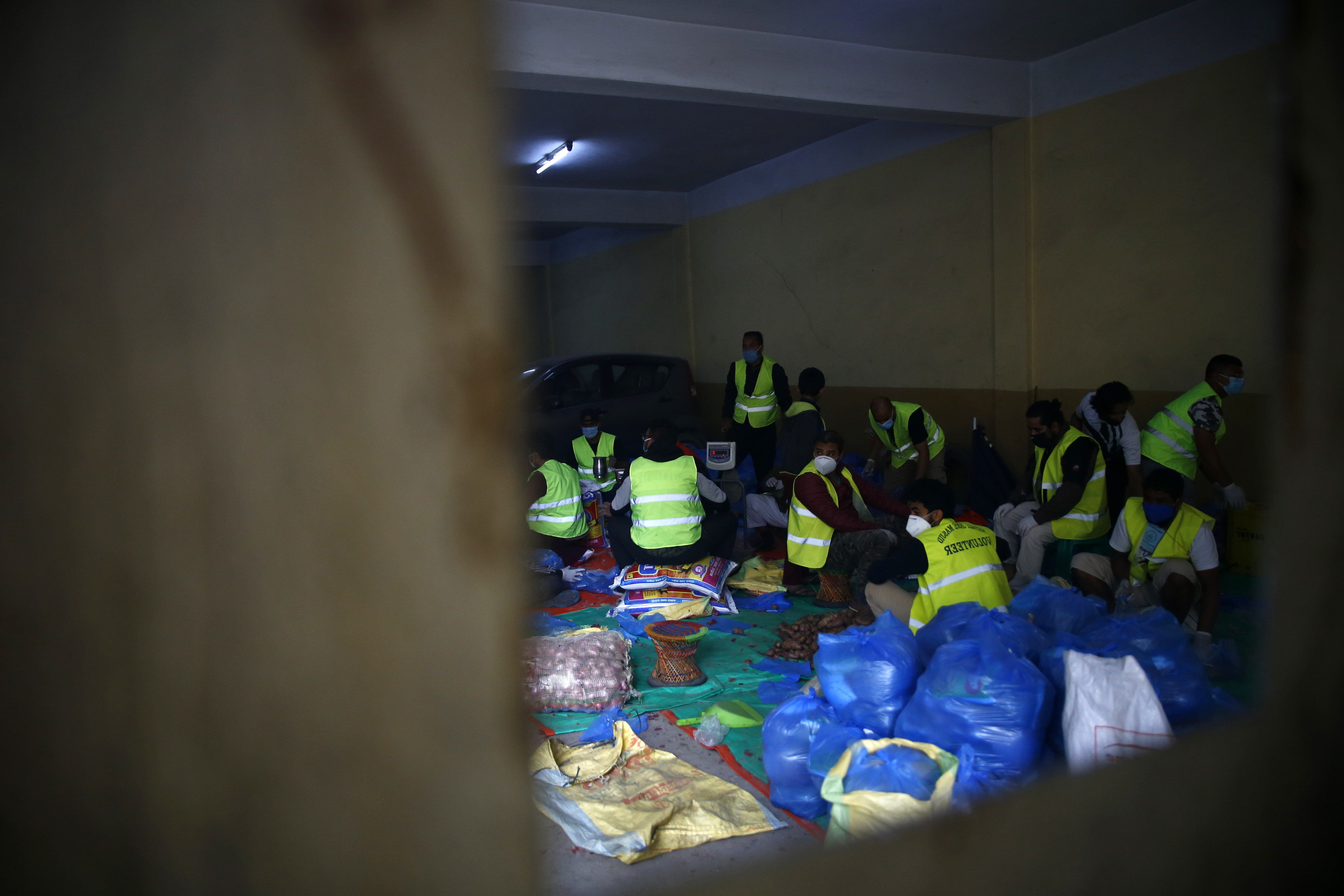 Volunteers from the Muslim community pack relief supplies for more than 500 families in need on the 33rd day of government-imposed lockdown, amid concerns over the spread of COVID-19, in Kathmandu, on Saturday, April 25, 2020. Photo: Skanda Gautam/THT