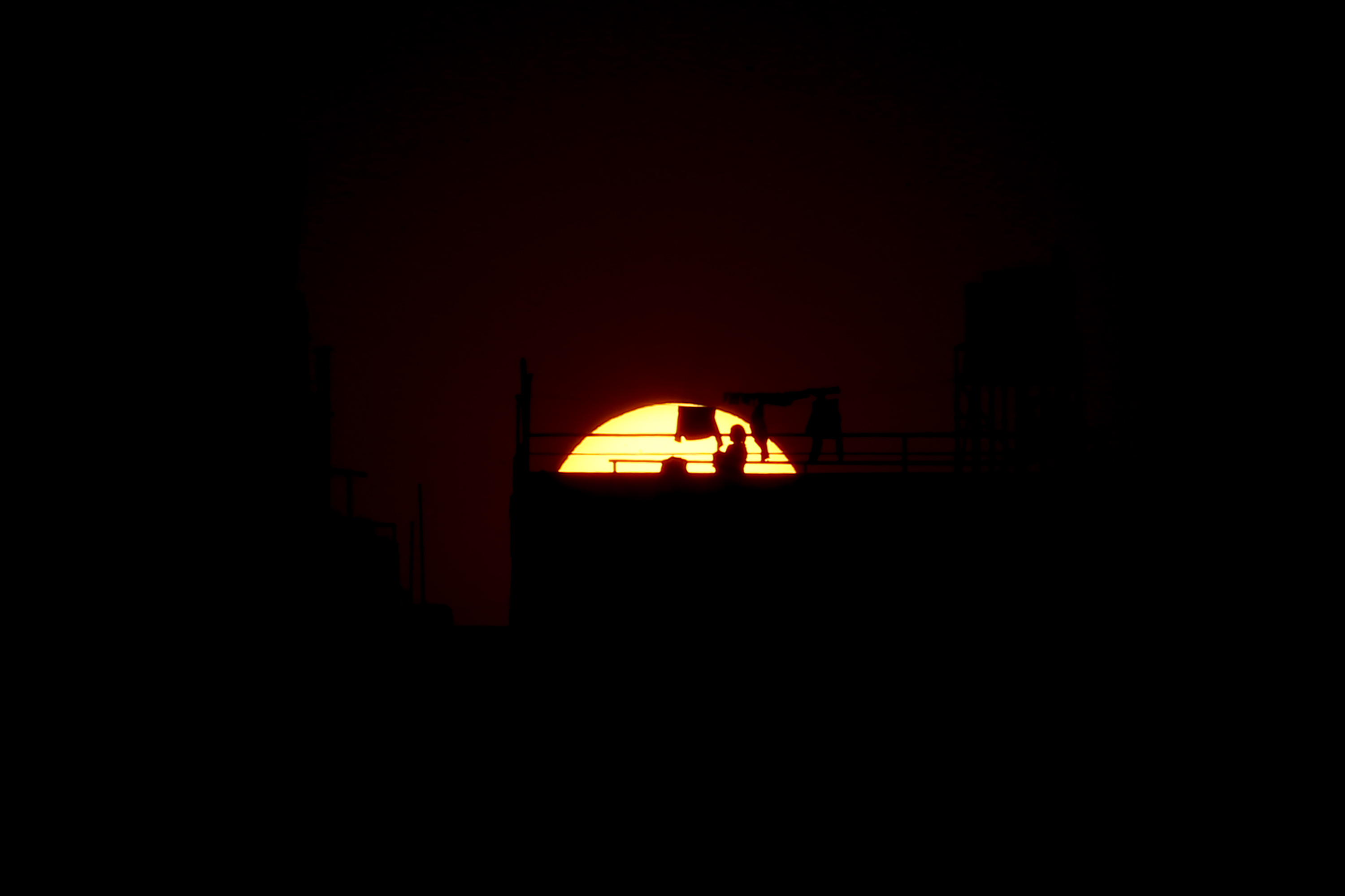 The silhouette of a woman is seen on the rooftop of her house on the twelfth day of the government imposed nationwide lockdown, in Kathmandu, on Saturday, April 4, 2020. Photo: Skanda Gautam/THT
