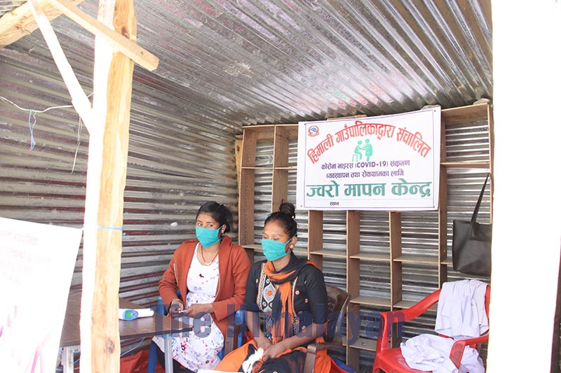 Health workers wearing cloth masks at the health desk  in Badhu, Himali Rural Municipality-7, Bajura district, on Tuesday, April 14, 2020. Photo: Prakash Singh/THT