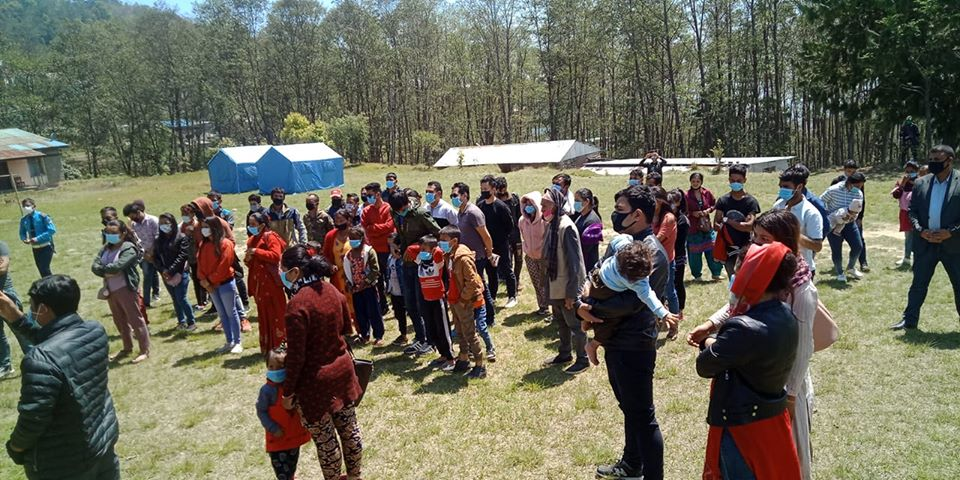 People returning from other districts wait for their health check-up at Deurali-based quarantine centre, in Bhojpur district, on April 4, 2020. They arrived in their home town amid lockdown imposed by the government to prevent the possible spread of pandemic COVID-19. Photo: Niroj Koirala/THT