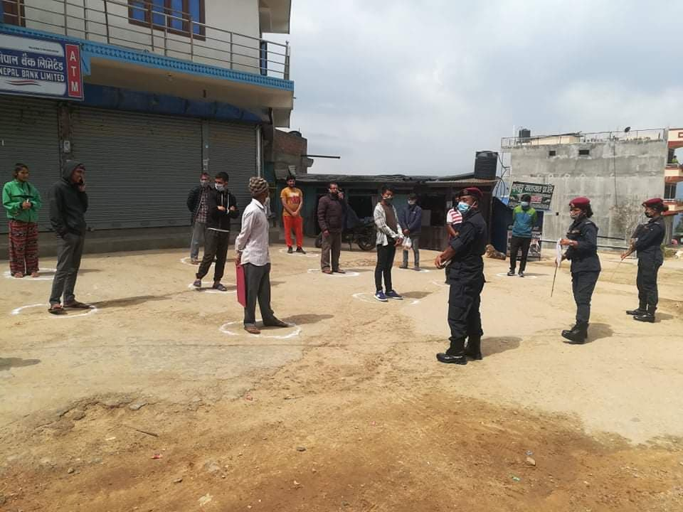 Locals detained by police are kept at a safe distance, in Chyangmini Chok of Bhojpur Municipality-7, on Saturday, April 18, 2020. Photo: Niroj Koirala/THT