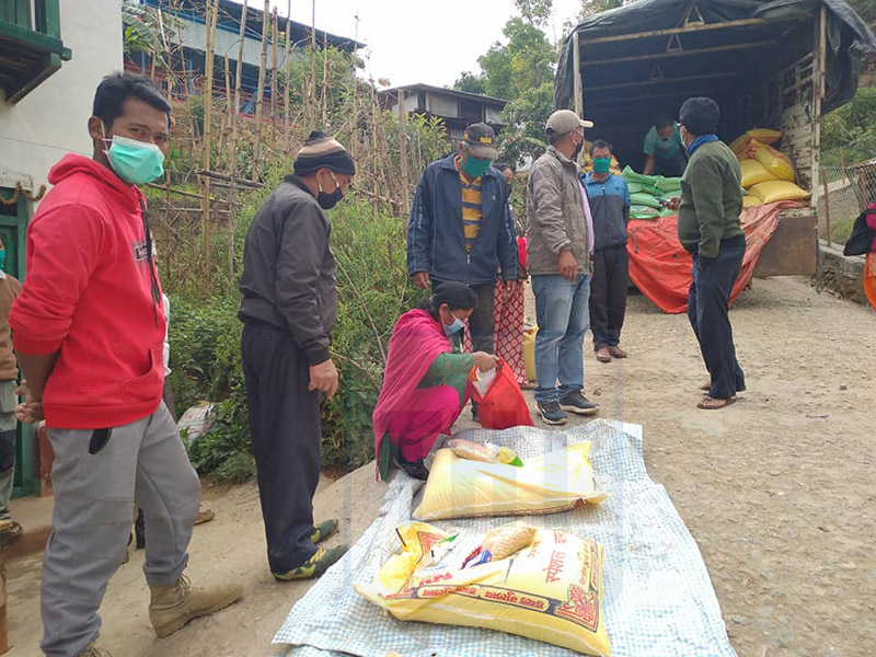 Relief materials being distributed in Bhojpur Municipality-9 of Bhojpur district. Photo: Niroj Koirala/THT