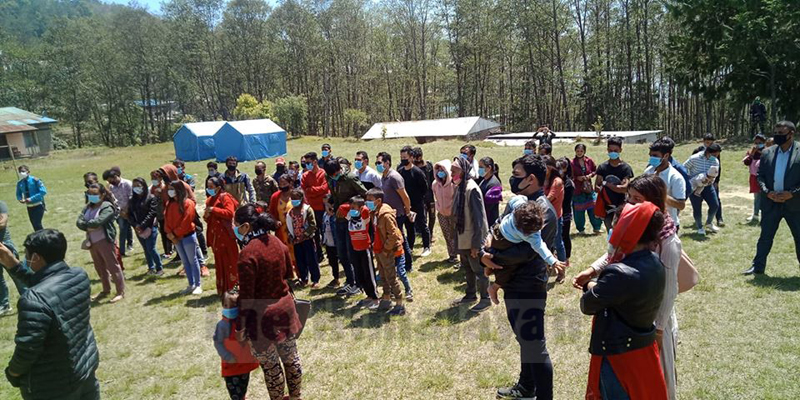 People returning from other districts wait for their health check-up at Deurali-based quarantine centre, in Bhojpur district, on April 2, 2020. They arrived in their home town amid lockdown imposed by the government to prevent the possible spread of pandemic COVID-19. Photo: Niroj Koirala/THT